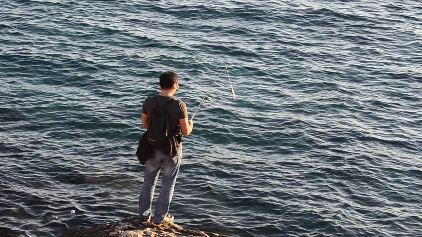 Fisherman on the coast of mediterranean sea. | Shutterstock HD Video #13028897