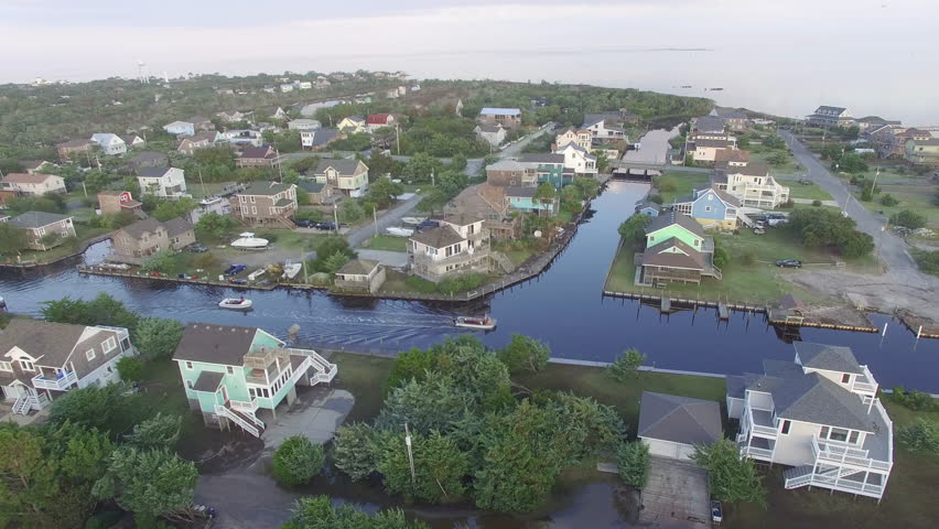 an establishing aerial shot of coastal real estate