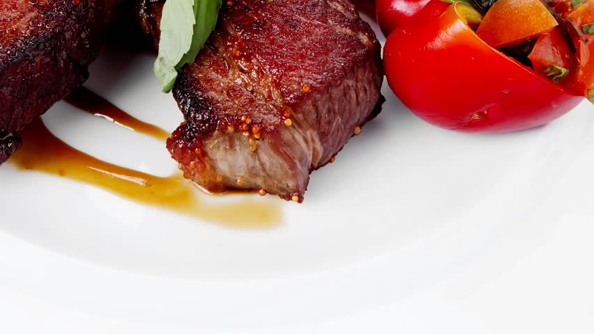 meat food : big grill beef steak on white plate with red hot chili pepper and raw cherry tomato 1920x1080 intro motion slow hidef hd
