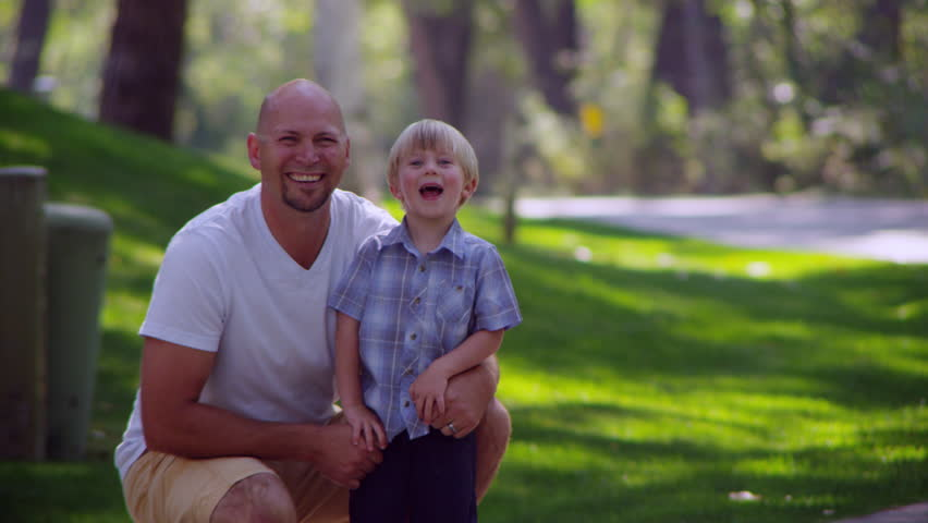 Portrait of father and son smiling   Shutterstock HD Video #13068137
