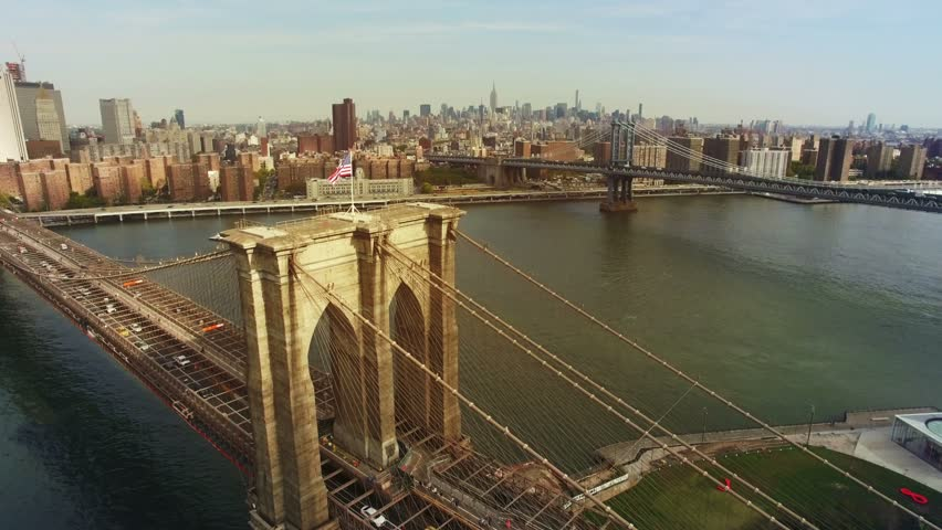 A toned aerial shot of Brooklyn Bridge, New York City. The camera is moving above Brooklyn bridge in the air approaching to Chinatown and upper Manhattan. 4K, Ultra HD video, DJI Phantom 3 pro. - 4K stock video clip