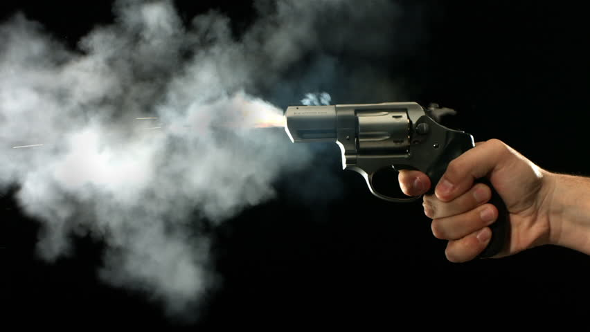 Cinemagraph - Revolver shooting and smoking, slow motion. Looping Motion Photo.
