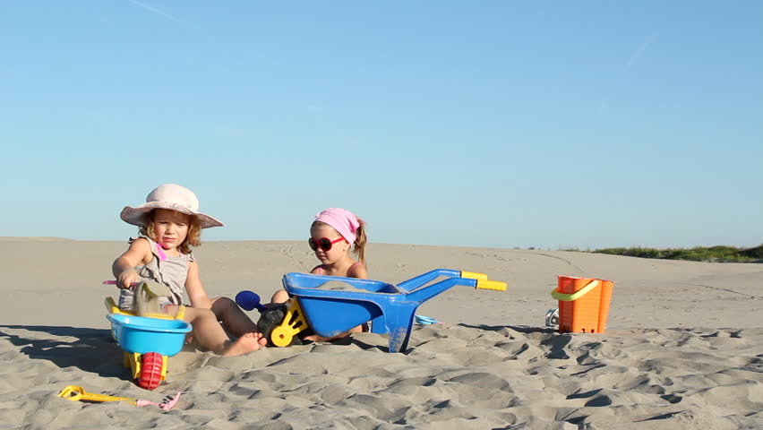 two little girls playing in sand - HD stock footage clip