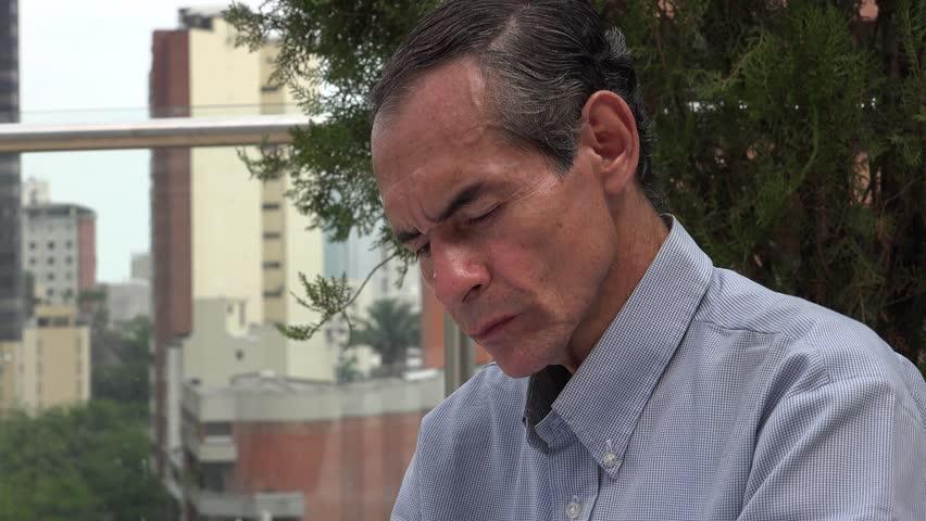 Man Reading in Urban Area   Shutterstock HD Video #13166336
