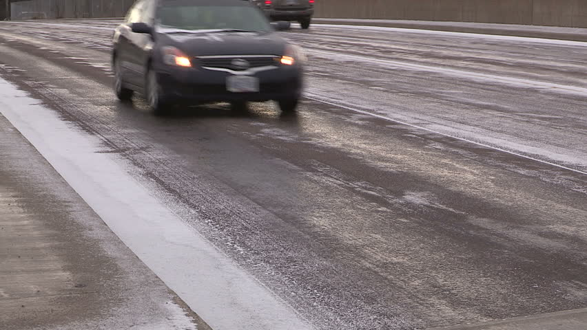 Kitchener, Ontario, Canada December 2014 Drivers and traffic on black ice on the highway with snow - HD stock video clip