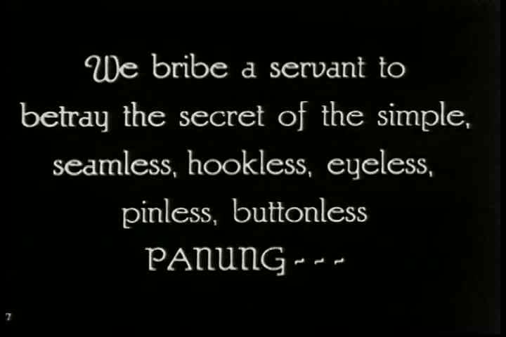CIRCA 1920s - A Siamese woman puts on the traditional panung. - SD stock footage clip