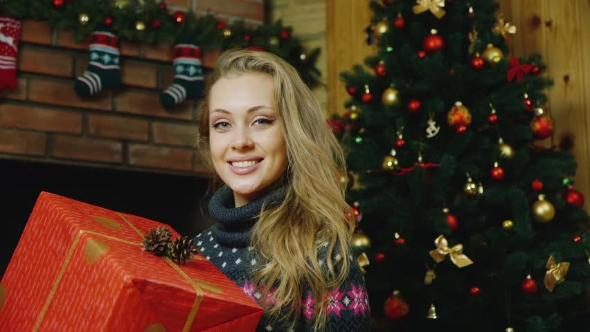 Beautiful woman with gifts around the Christmas tree | Shutterstock HD Video #13278080