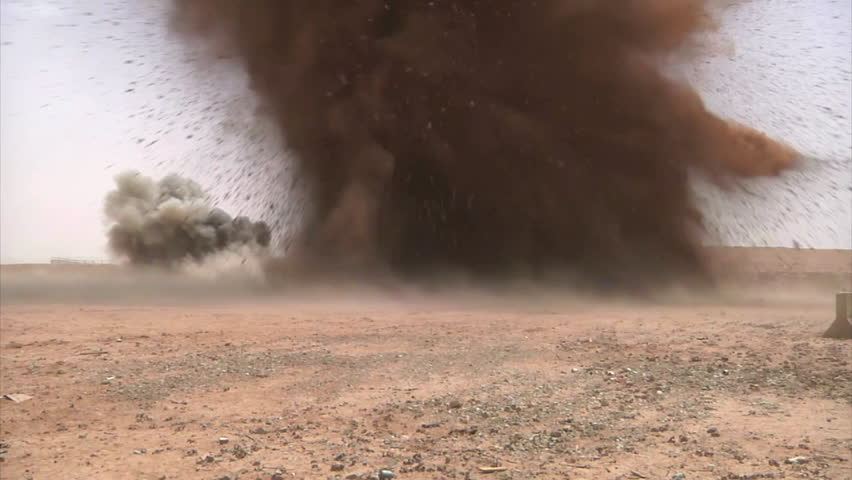 CIRCA 2010s - U.S. soldiers in Iraq conduct a weapons demolition resulting in a large explosion.