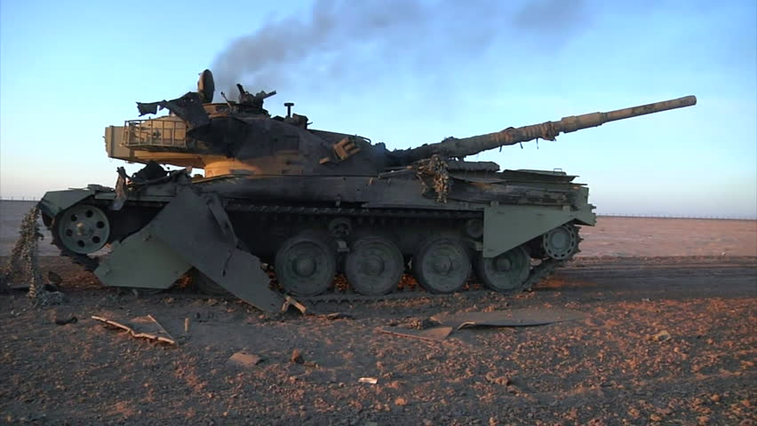 CIRCA 2010s - A destroyed tank sits in the Iraq desert.