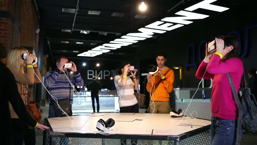 MOSCOW, RUSSIA - NOVEMBER 26, 2015: Virtual reality game. Young people uses a head mounted display. The Museum of Moscow. Biennale of high technologies SMIT: 60 minutes in tomorrow. - HD stock video clip