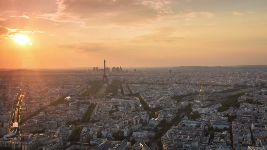Paris city skyline cityscape aerial view time lapse from day to night pan panning starting at the sunset ending with city illuminated | Shutterstock HD Video #13383011