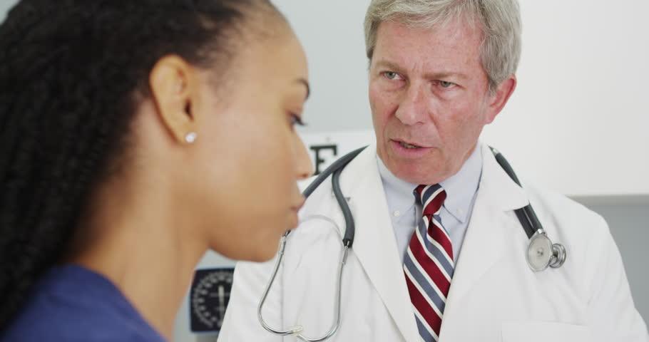 Black woman patient talking to her doctor | Shutterstock HD Video #13397663