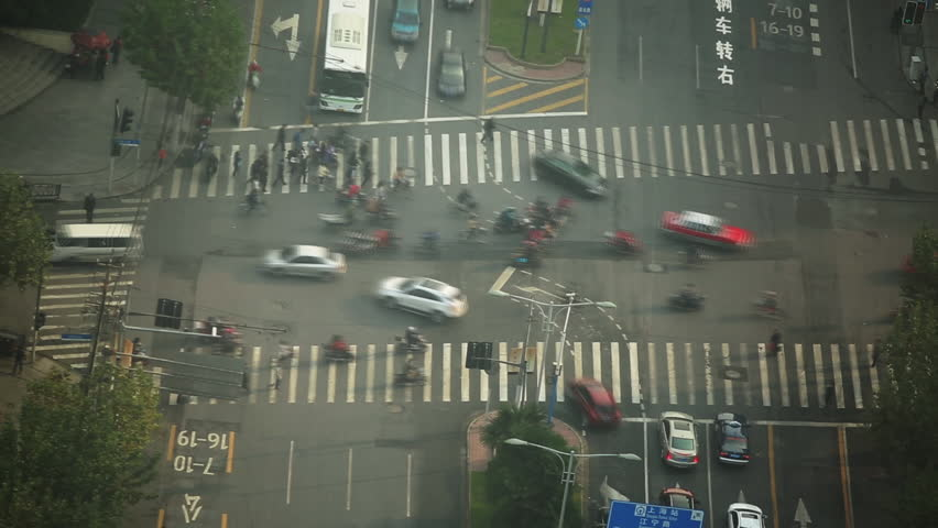 Time lapse of busy street traffic at a cross intersection in Shanghai, China