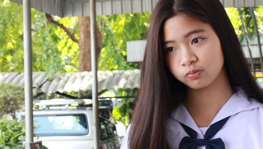 Portrait Of Thai Student Teen Beautiful Girl Using Her
