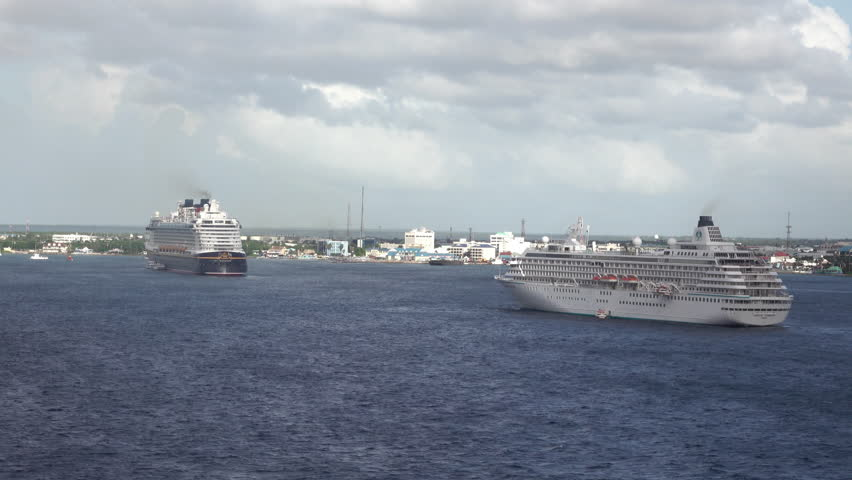 GRAND CAYMAN - NOV 2015: Grand Cayman Island cruise ship anchored Caribbean. Tourism and off shore banking are main economic stimulus. Beach and resorts cater to tourists. Vacation destination.