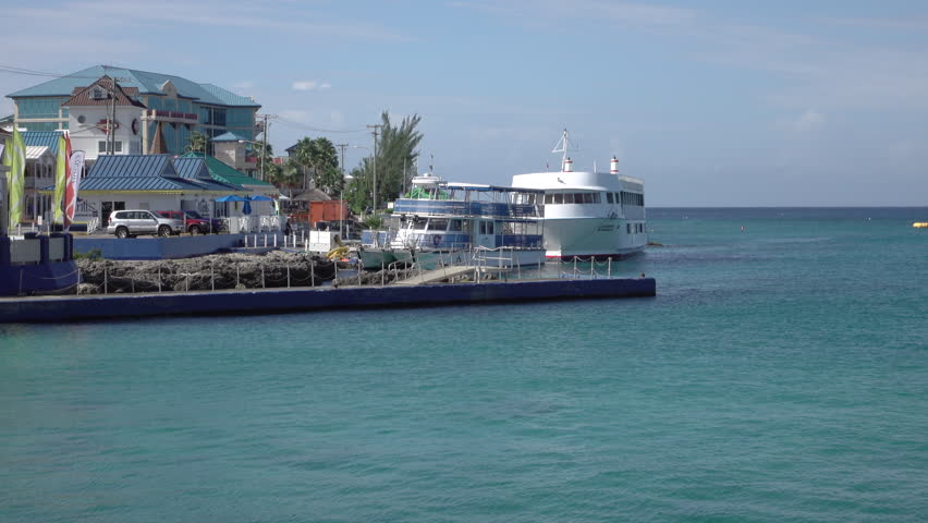 GRAND CAYMAN - NOV 2015: Grand Cayman marina shore boats Caribbean. Tourism and off shore banking are main economic stimulus. Beach and resorts cater to tourists. Vacation destination.