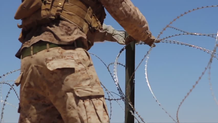 CIRCA 2010s - The U.S. military builds a barbed wire enclosure to house enemy POWs. - HD stock footage clip