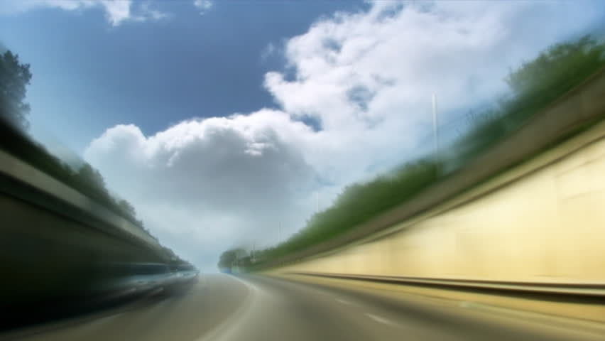 Road with time lapse clouds speed tunnel - HD stock video clip