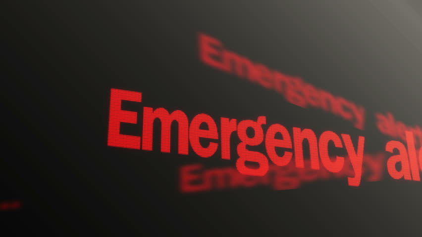 Emergency alert. Please stand by. Warning red text running on computer display - 4K stock footage clip