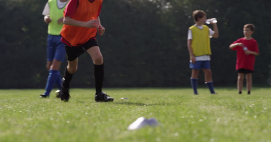 Group of boys in a soccer training. - 4K stock footage clip