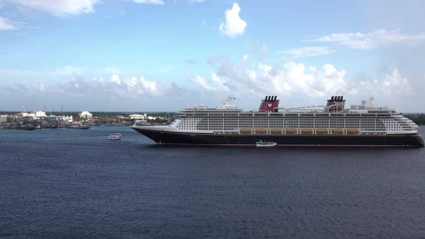 GRAND CAYMAN - NOV 2015: Grand Cayman Island Disney cruise ship Caribbean vacation. World famous off shore banking investment center. Beach, scuba diving and resorts cater to tourists. Luxury travel.
