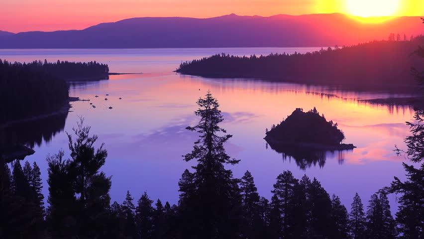 LAKE TAHOE, NEVADA - CIRCA 2015 - A beautiful sunrise establishing shot of Emerald Bay at Lake Tahoe. | Shutterstock HD Video #13596176