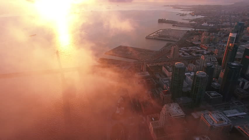 4K Aerial drone shot San Francisco downtown bay bridge sunrise above clouds #13597913