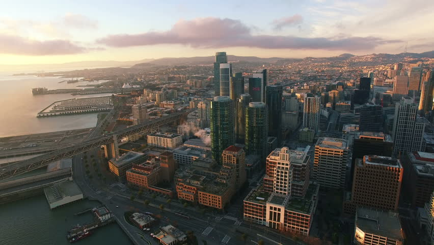 4K Aerial drone shot San Francisco toward buildings downtown embarcadero sun #13597940