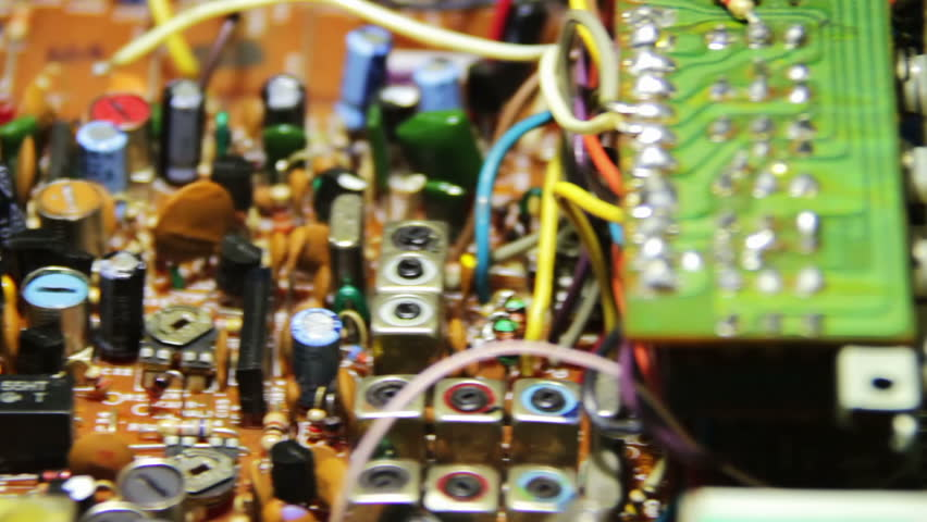 Close-up of electronic radio circuit with electronic components in motion. - HD stock footage clip