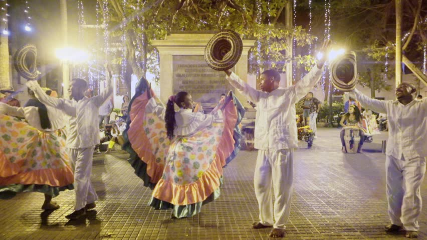 CARTAGENA, COLOMBIA - CIRCA DECEMBER 2015: Afroamerican dancers performing Colombian folkloric dance on  a public square. Slow motion