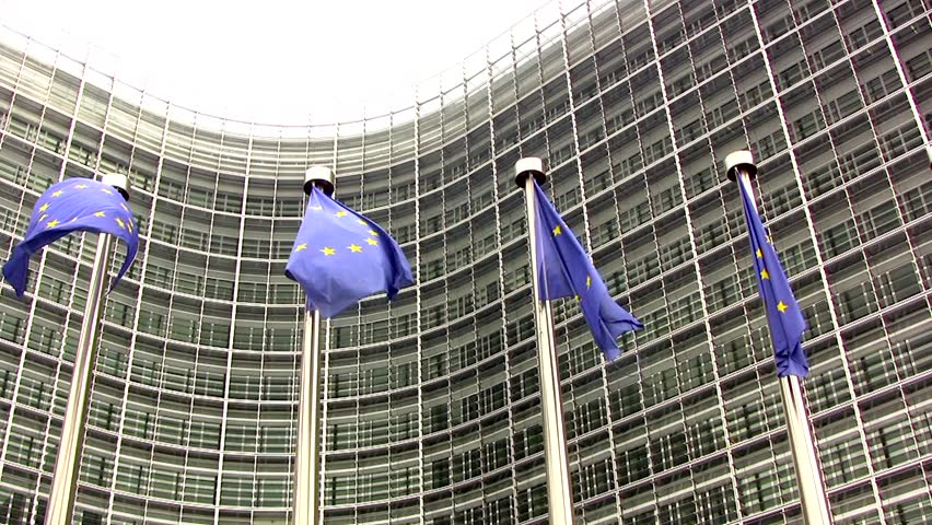 Bruxelles/ Brussels, Belgium - November 30, 2010: Exterior of the building of The European Commission, Euro Flags fluttering in the breeze - HD stock footage clip