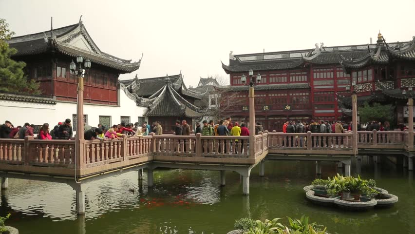 Famous Fangbang Yuyuan shopping area in Shanghai, China, with gorgeous ancient shop buildings and tourists. - HD stock video clip