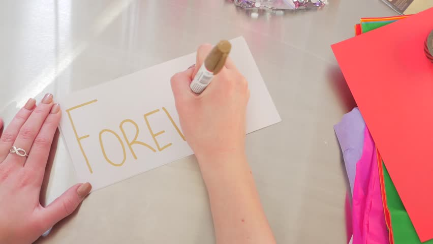 Female Hands Writing Forever On A White Piece Of Paper - HD stock video clip