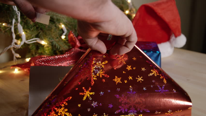 Holiday gift wrapping - christmas presents with bows and wreaths close up object | Shutterstock HD Video #13748285