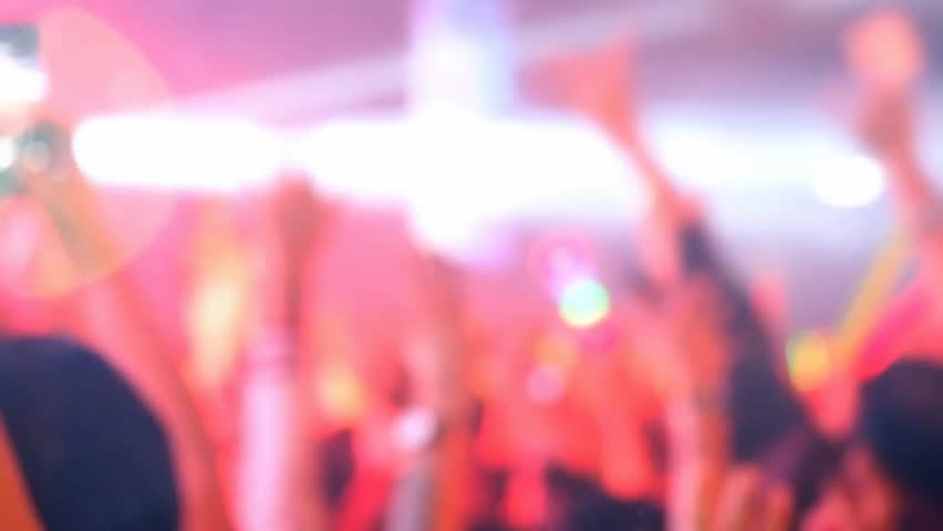 blurred focused concert crowd in hall - HD stock video clip