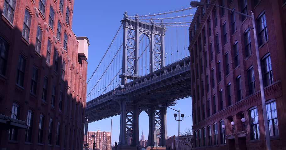 The Iconic Manhattan Bridge Viewed From Dumbo, Brooklyn. Zooming in from between two brick buildings with the Empire State building framed in the bottom of the bridge. (New York, August 2015) | Shutterstock HD Video #13782251