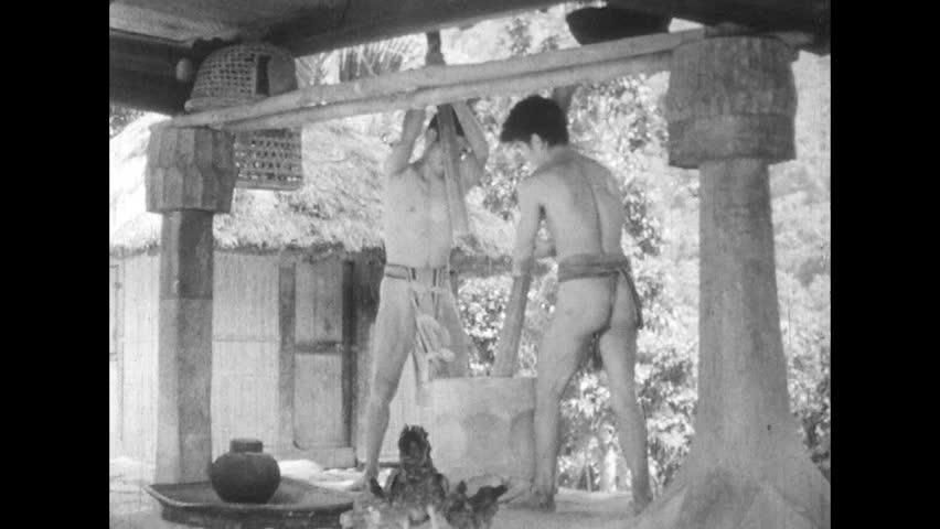 ASIA 1960s: Village Members Prepare Rice in Ifugao Village