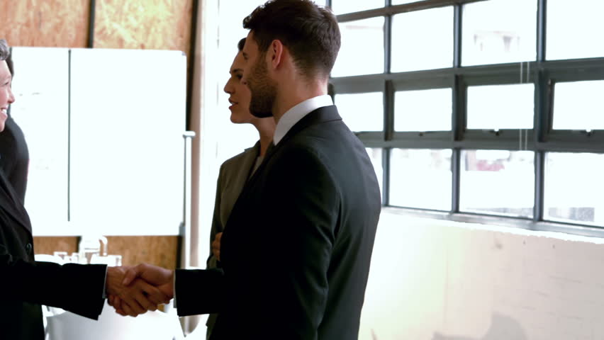 Business people handshaking in slow motion - HD stock footage clip