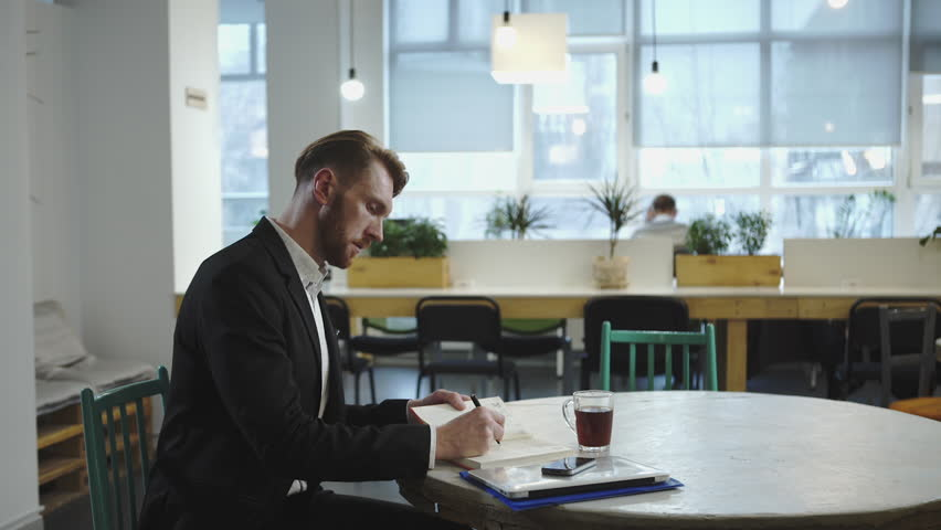 Man working and waiting for the meeting with the business partner - HD stock footage clip