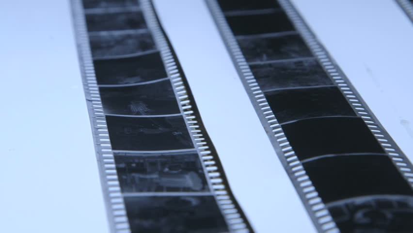 Strips of 35mm black and white film negatives ready for cutting and archiving dolly shot - HD stock video clip