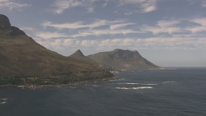 South Africa Sea Waves Mountain Peak Clouds - South Africa, September, 2014 - HD stock video clip