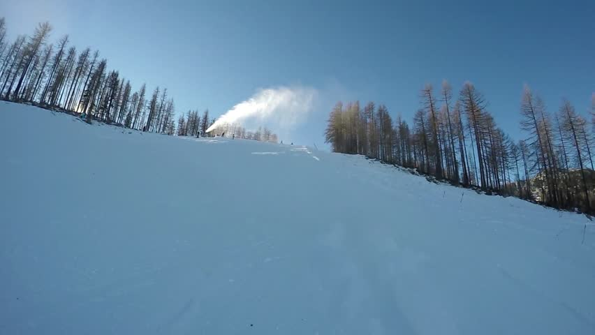 Back view slow speed skiing on the ski slopes at sunny day. Slow motion effect used. | Shutterstock HD Video #13872269