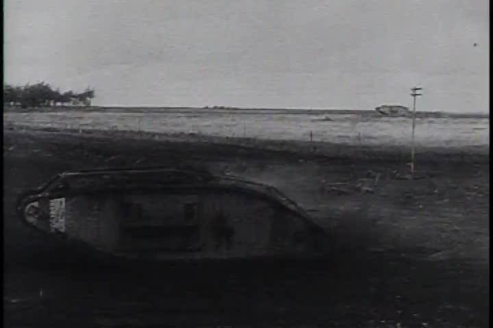 CIRCA 1970s - Footage of a tank in WWI and air strikes help the narrator explain the beginning of WWII in 1939. - SD stock video clip