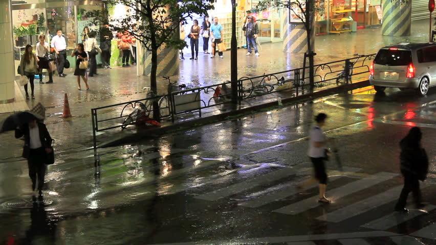 Crosswalk on a street in Tokyo during a typhoon.