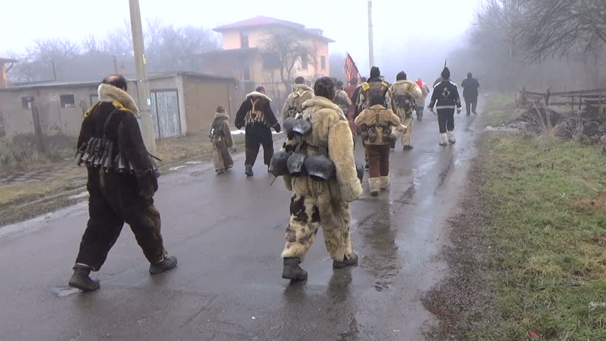 BOGDANOV DOL, BULGARIA  January 14, 2016: Kukeri  Bulgarian mummers with scaring masks on Surva  very old ritual from pagan times, registered as part of the world culture heritage with UNESCO - HD stock video clip