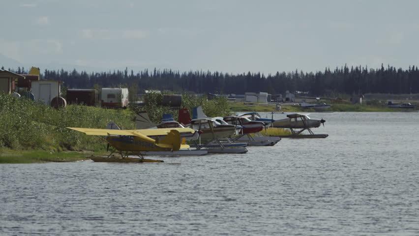 Fairbanks, Alaska, USA - JULY 2015. Float Planes Parking On The Lake  In Fairbanks International Airport. Canon C300. - HD stock video clip