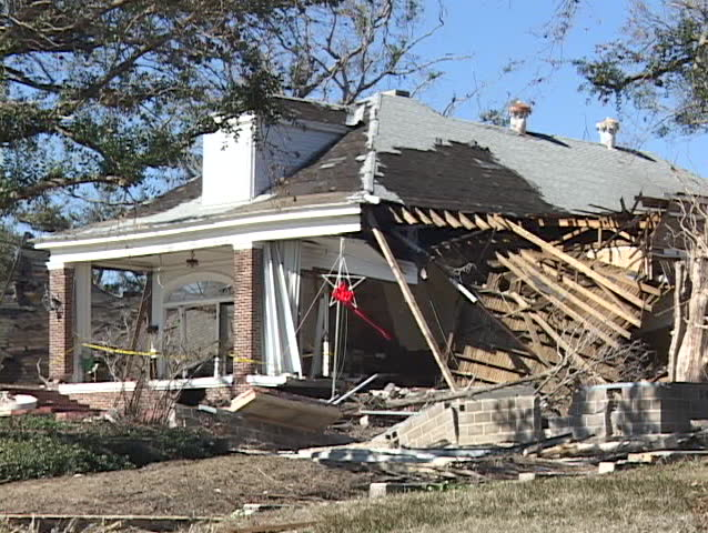 A house reduced to a pile of rubble shows the destruction of Hurricane Katrina.
