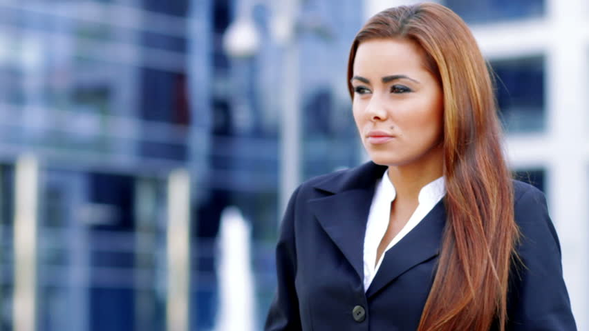 Attractive business woman using mobile phone outside office building - HD stock footage clip
