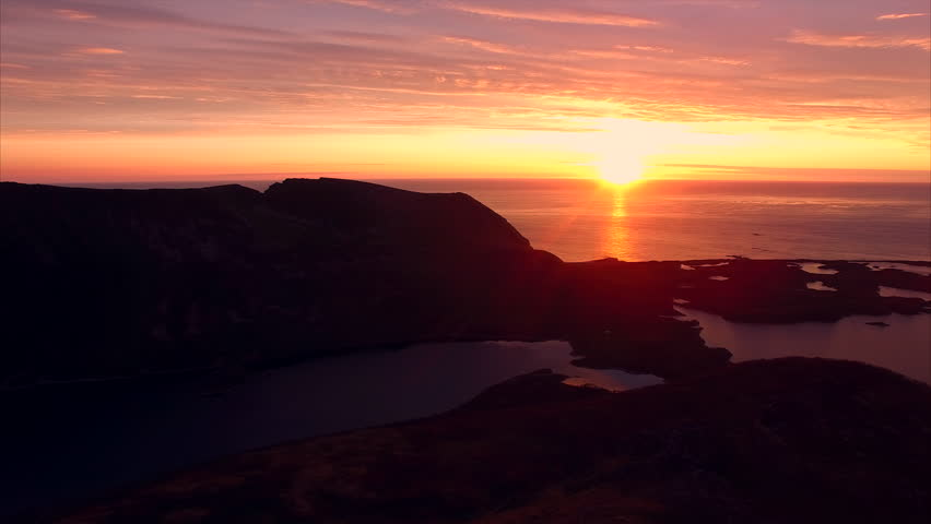 Aerial view of midnight sun over the ocean on island of Andoya in Norway. Aerial 4k Ultra HD. - 4K stock video clip