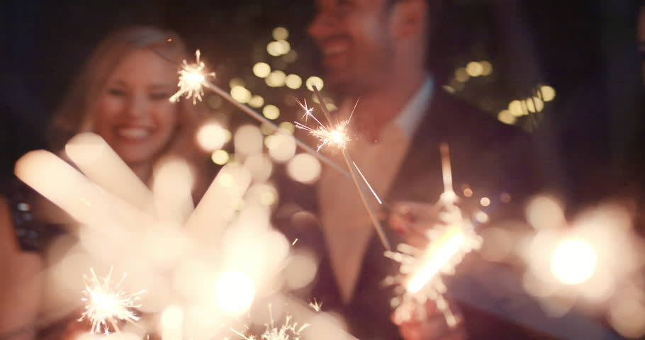 Sexy happy group of friends at glamorous party lighting sparklers having fun smiling celebrating new year's eve. | Shutterstock HD Video #14075948